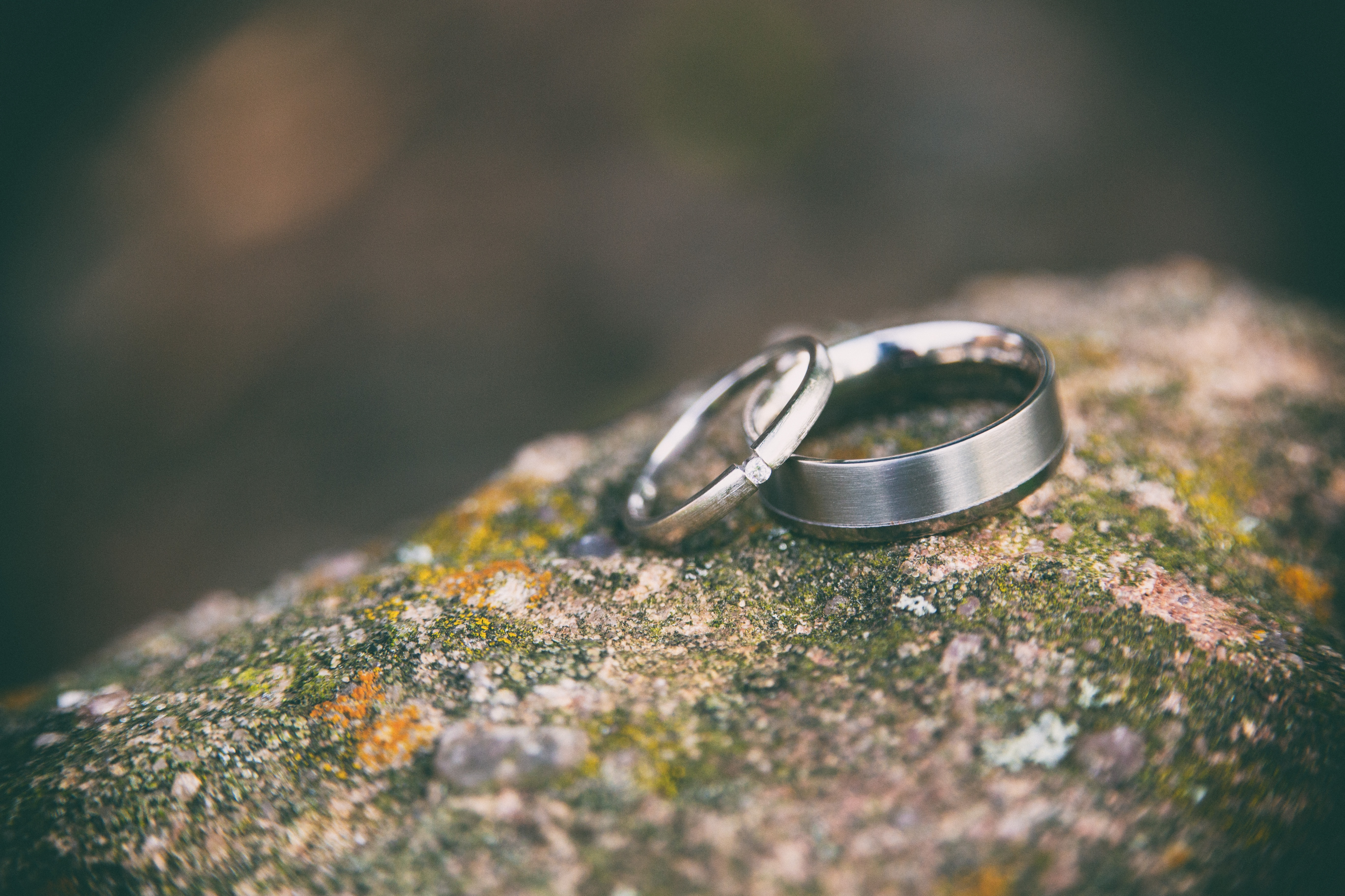 two wedding silver wedding rings on a rock